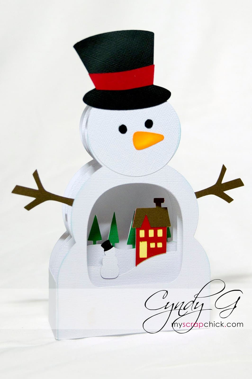 3d card shaped like a snowman with a wintry scene inside